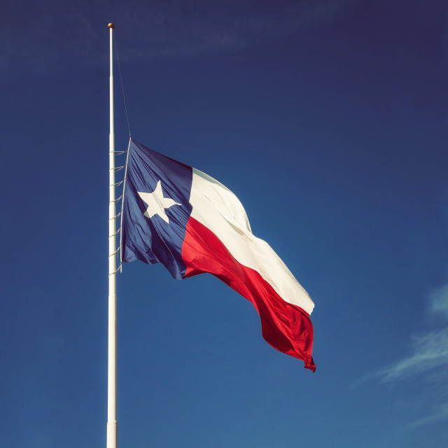 """State flag of Texas flying at half-mast"" stock image"