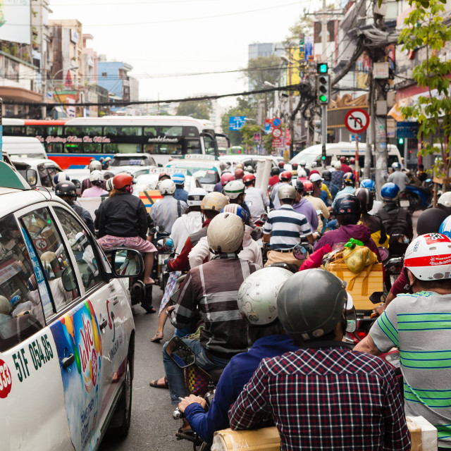 """Heavy traffic on the Ho Chi Minh City street"" stock image"