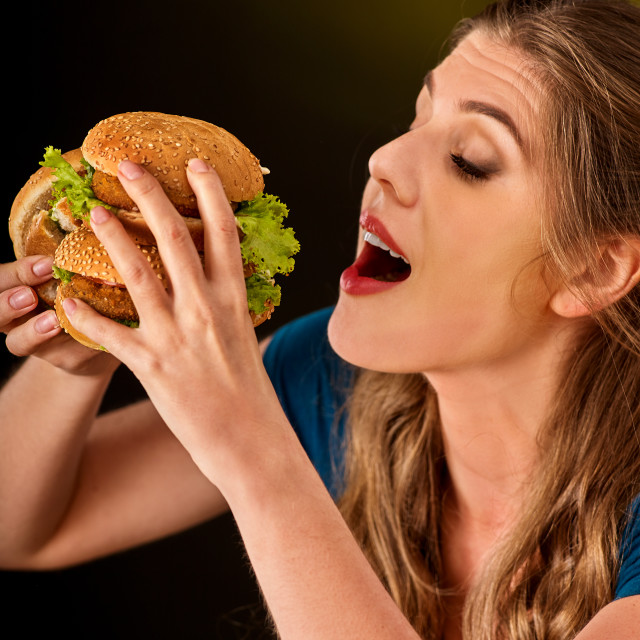 """Girl eat big hamburger. Fastfood concept."" stock image"