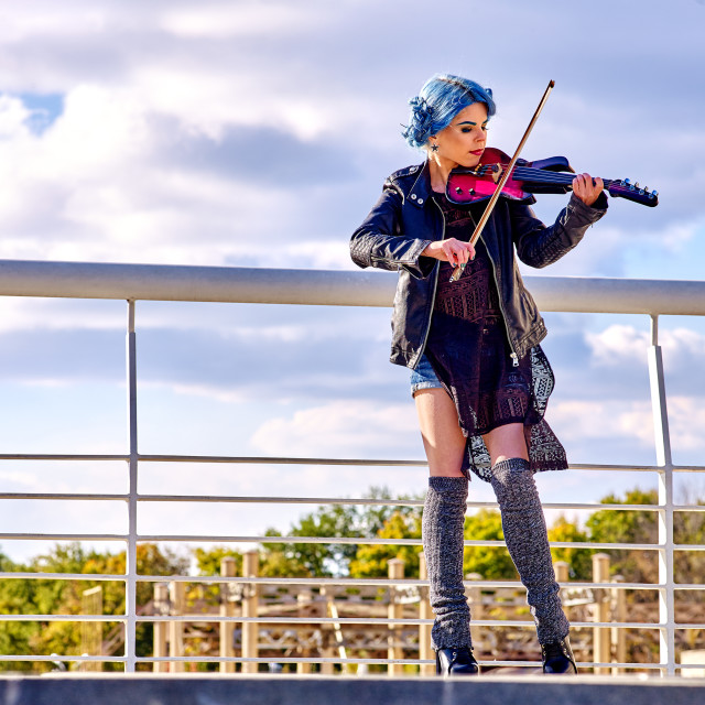 """Music street performers with girl violinist"" stock image"