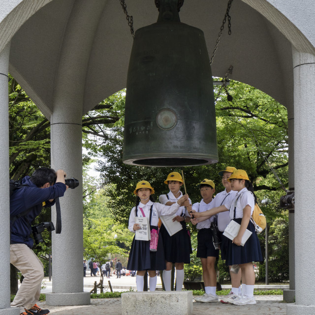 """""""Hiroshima, Japan - May 25, 2017: Students ringing the peace bell in Peace..."""" stock image"""