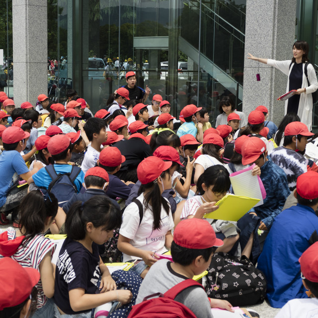 """""""Hiroshima, Japan - May 25, 2017: Group of students sitting in front of the..."""" stock image"""