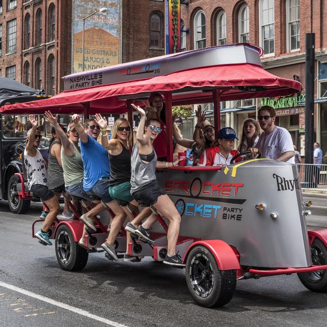 """Sprocket Rocket party bike on Broadway, Nashville"" stock image"