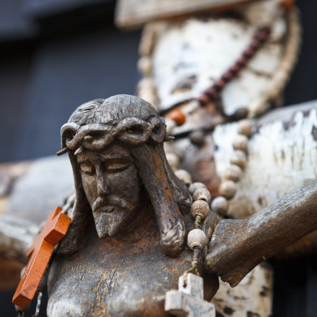 """Wooden sculpture of Jesus with rosary on cross"" stock image"