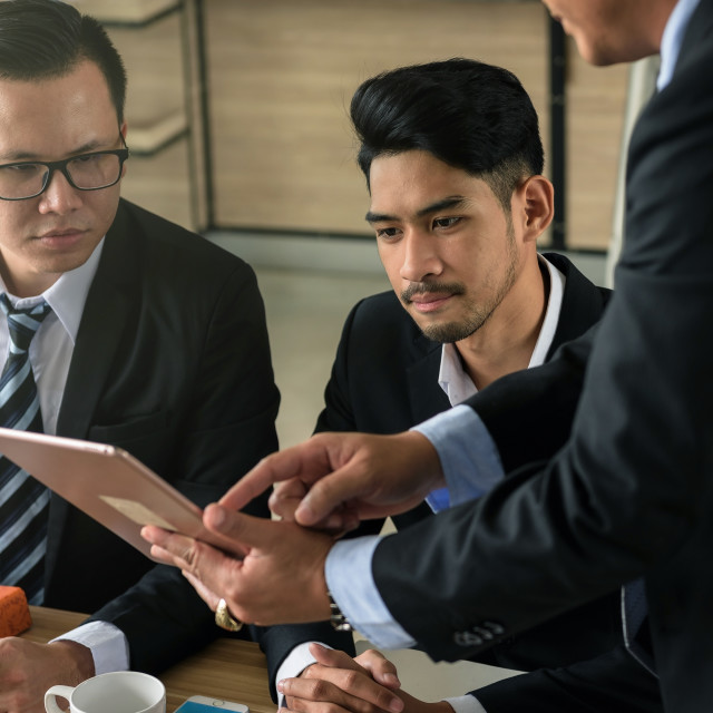 """""""businessman team discuss project using tablet"""" stock image"""