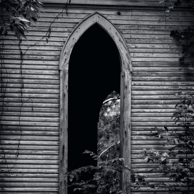 """Peeking Through the Church Window"" stock image"