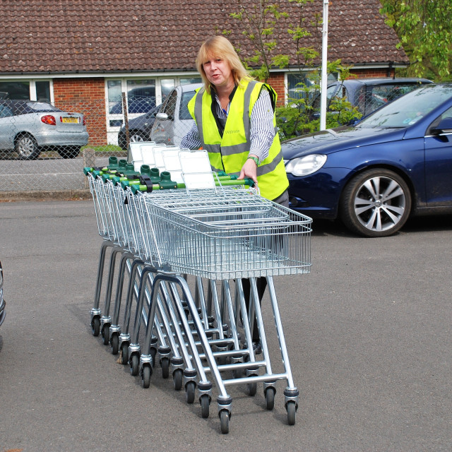 """Trolley collecting, Waitrose"" stock image"
