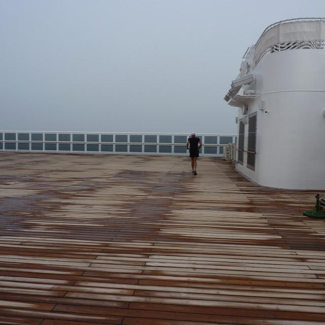 """lone jogger on QM2 deck"" stock image"