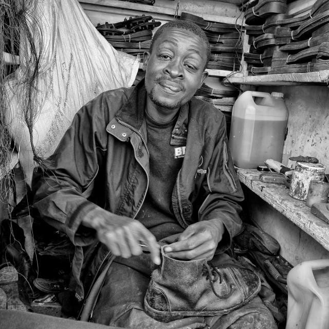 """Kibera Cobbler"" stock image"