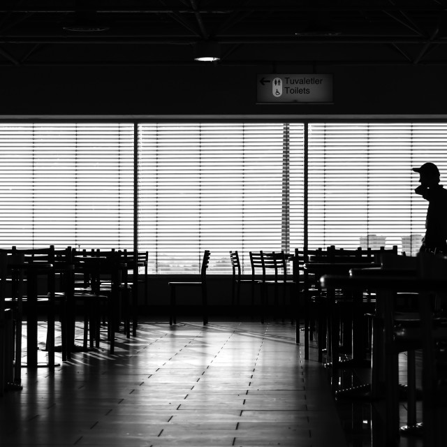 """""""Walking man in airport cafe silhouette"""" stock image"""