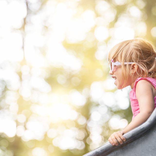 """""""Happy blond girl on a slide"""" stock image"""
