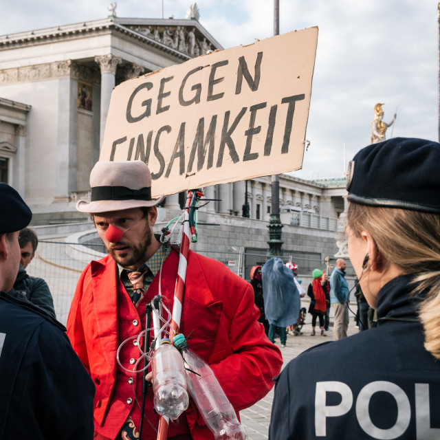 """""""People in costumes of mimes and clowns protest against Austrian ban on full-face veil in public places"""" stock image"""