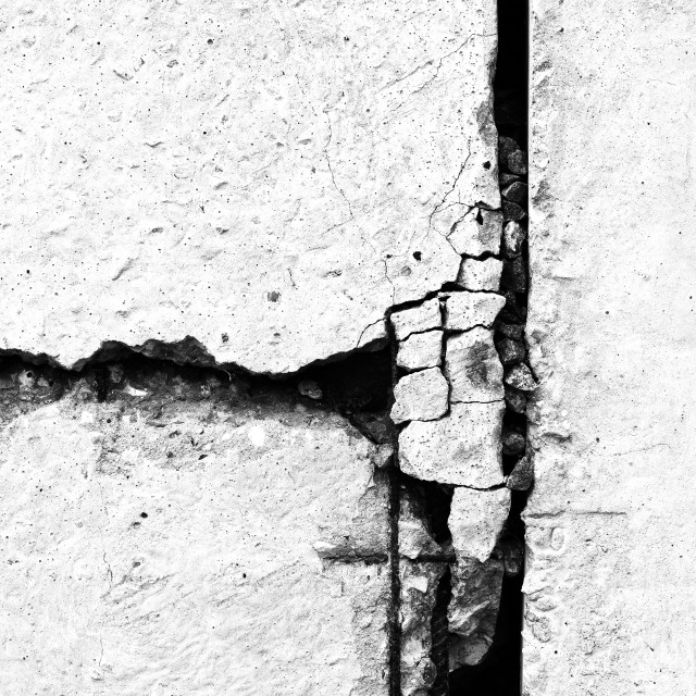 """""""Vertical rusty crack in concrete textured background"""" stock image"""