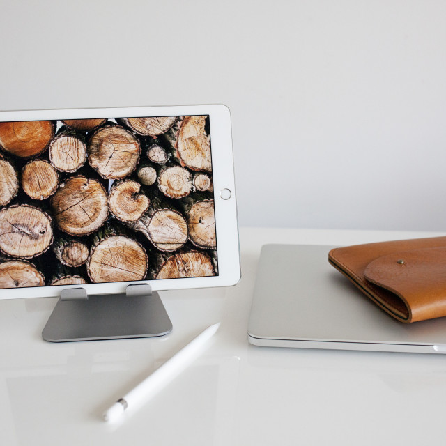 """""""Workspace with laptop, ipad and leather case"""" stock image"""