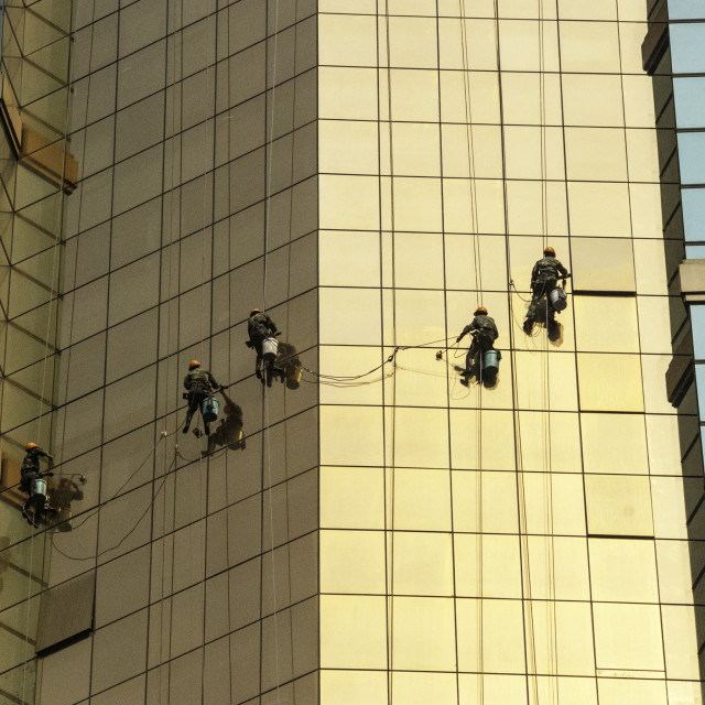 """Shanghai skyscraper window washers"" stock image"