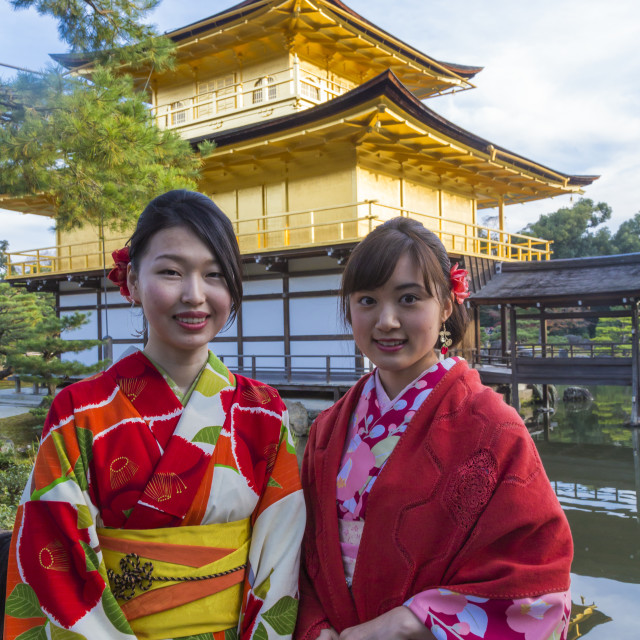 """""""Women in traditional Japanese kimonos in front of the Golden Pavilion temple..."""" stock image"""