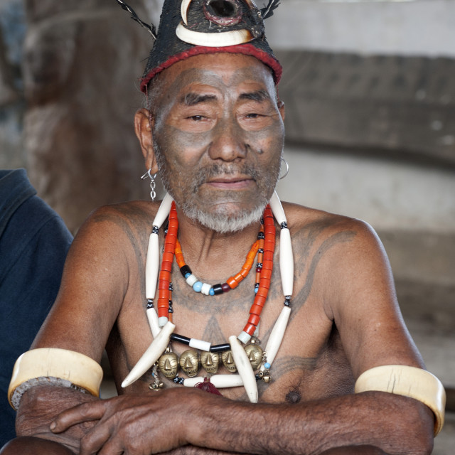 """Naga head hunter, Wokshing Pensha, wearing Naga tribal necklaces and hat, and..."" stock image"