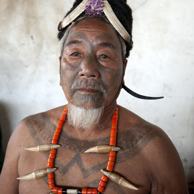 """Naga man, Nokphong Wangpen, head hunter, with chest tattoo marking him as..."" stock image"