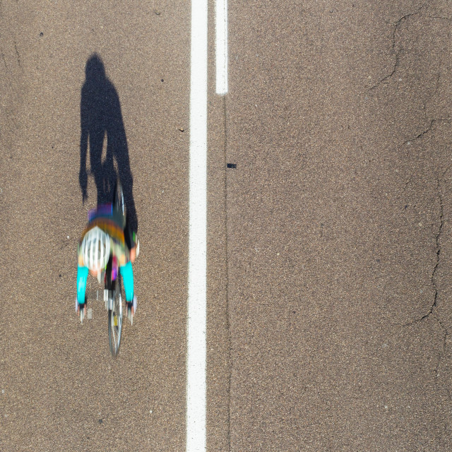 """""""Cycling Speed Blur Overhead"""" stock image"""