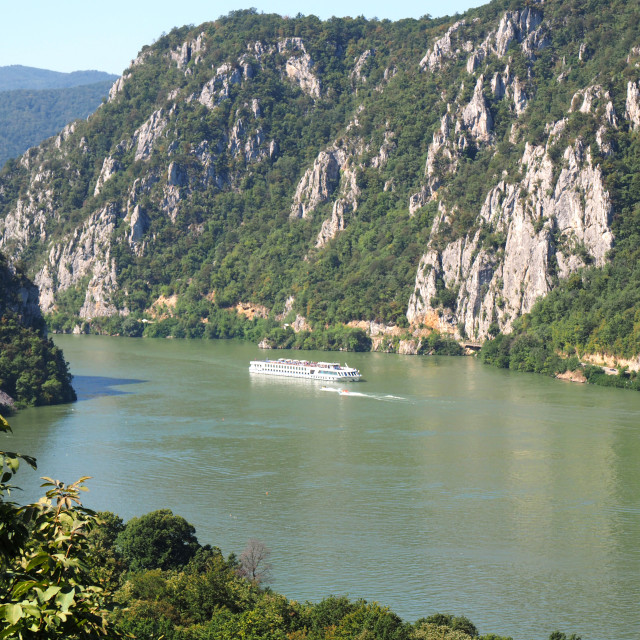 """Boat in Danube canyon on Romania border"" stock image"