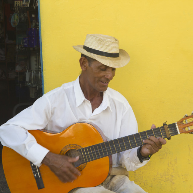 """""""A man is playing the acoustic guitar and sings in a street of Trinidad"""" stock image"""