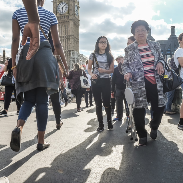 """People walking across Westminster Bridge"" stock image"