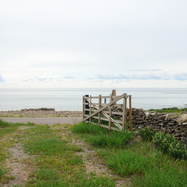"""Pathway to the sea with a wooden gate"" stock image"