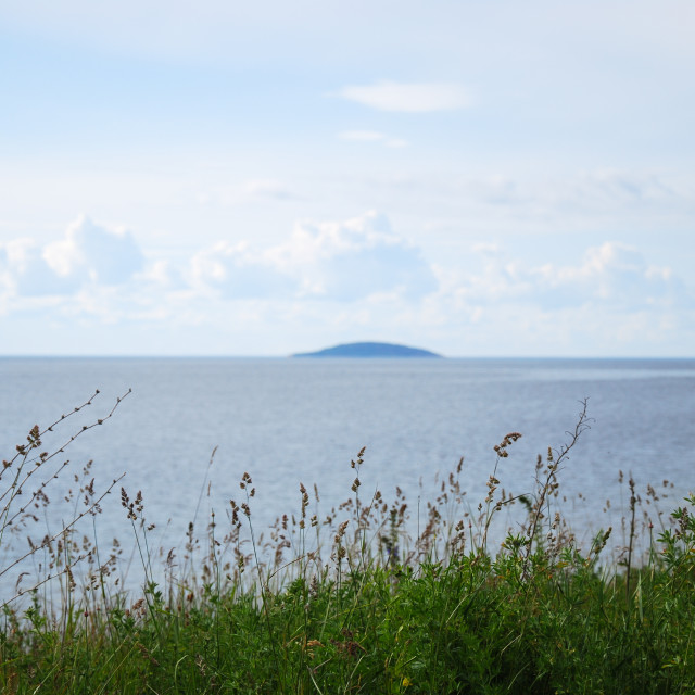 """View at a blue island in the horizon"" stock image"