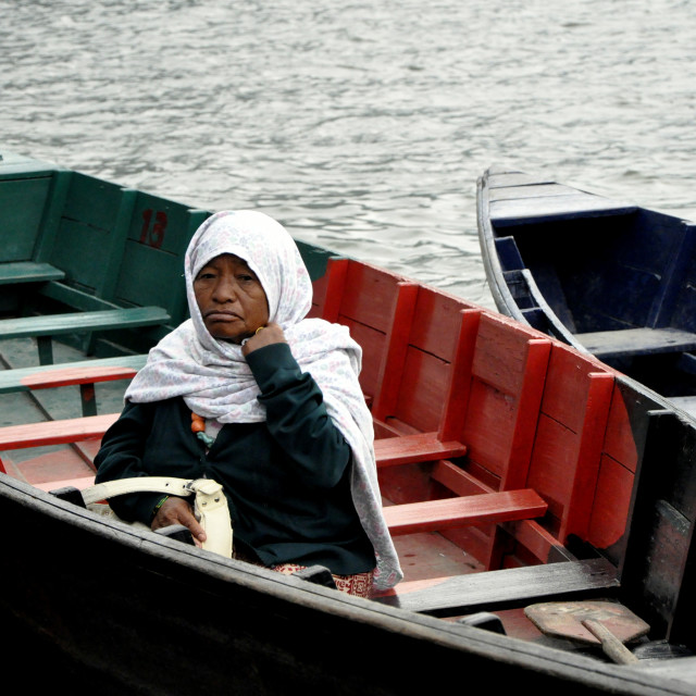 """""""Woman in a boat"""" stock image"""