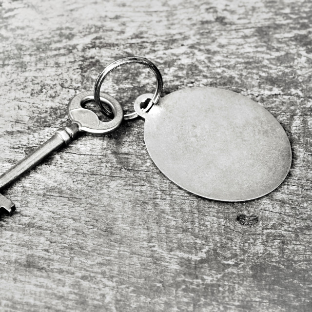 """old key on ring on wooden background"" stock image"