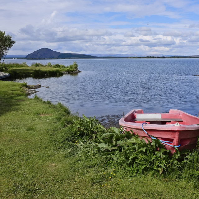 """""""Rowing boat by the shore of Lake Myvatn, Iceland"""" stock image"""
