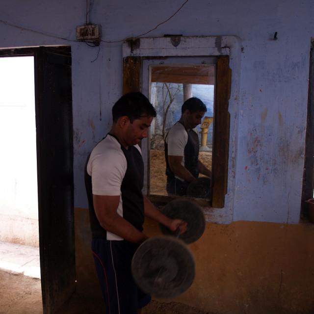 """Man weightlifting in a gym, Varanasi, India"" stock image"