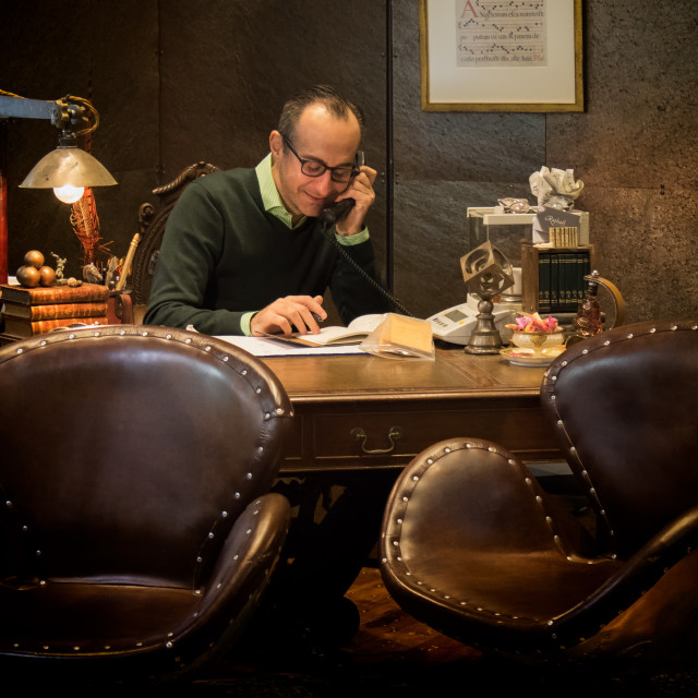 """Man in Office with antiques"" stock image"