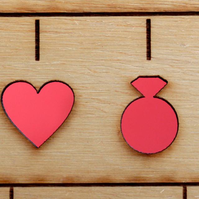 """laser engraved symbols of wedding, bride, groom, heart, ring and cake"" stock image"