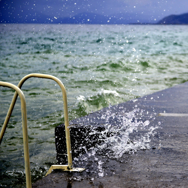 """The waves breaking on a concrete embankment on lake ohrid, macedonia"" stock image"