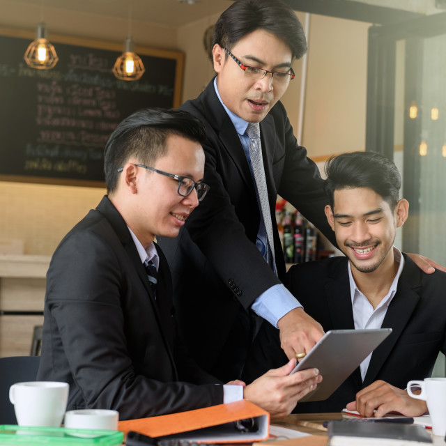 """""""businessman boss coaching team by tablet"""" stock image"""