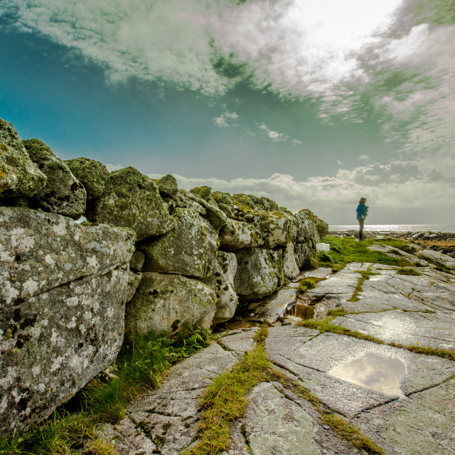 """solitary figure in rocky landscape."" stock image"
