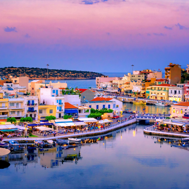 """The lake Voulismeni in Agios Nikolaos, a picturesque coastal town with colorful buildings around the port in the eastern part of the island Crete, Greece"" stock image"