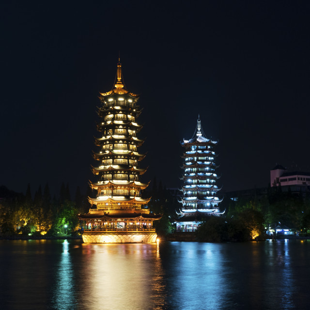 """The Sun and Moon Twin Pagodas illuminated at nigh in the city of Guilin, China"" stock image"