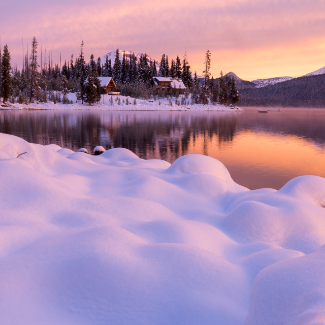 """Snowy Cabins During Sunrise"" stock image"