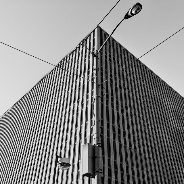 """A symmetrical shot of the exterior of a concrete urban building"" stock image"