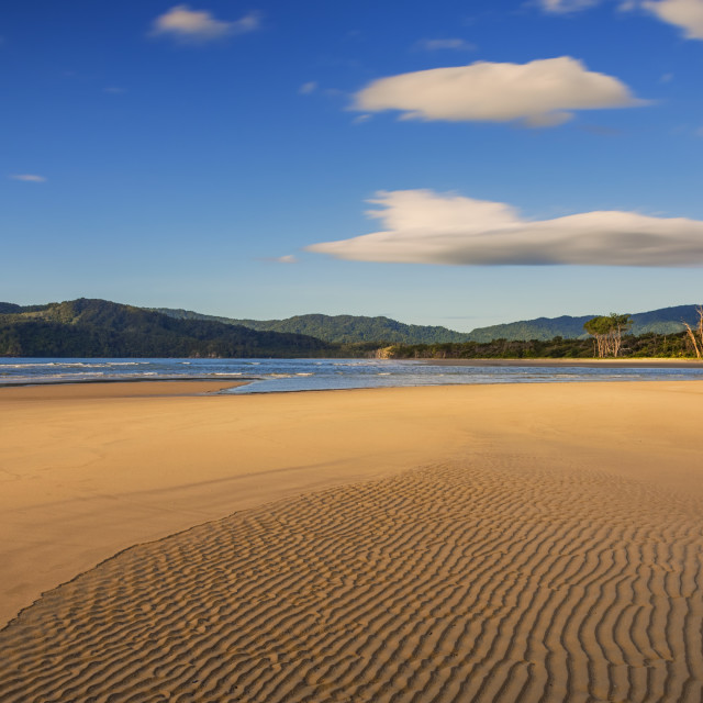 """Deserted Beach Blue Sky"" stock image"