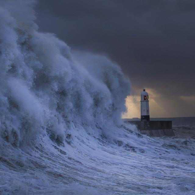 """Storm wave and Porthcawl lighthouse at sunrise"" stock image"