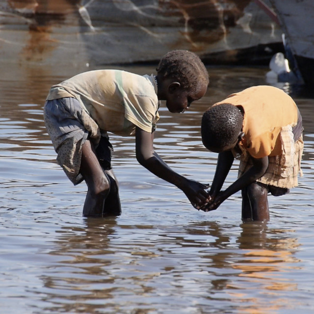 """""""The Nile - two children wash"""" stock image"""