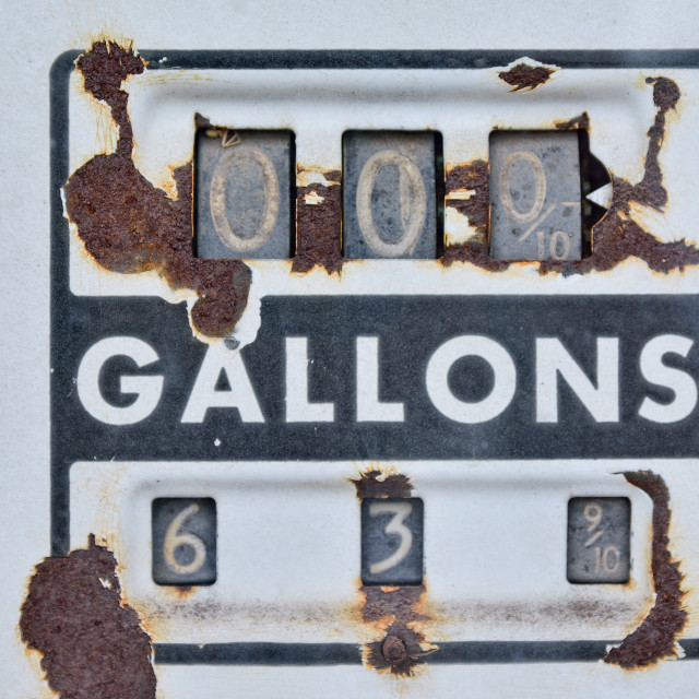 """Old rusty american gas pump panel."" stock image"