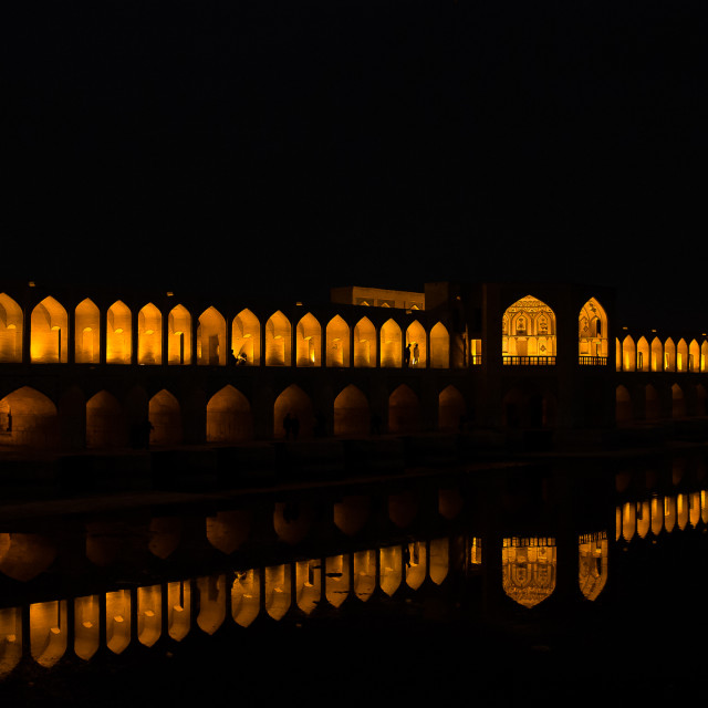 """Khaju bridge over Zayandeh River at night. Isfahan, Iran"" stock image"
