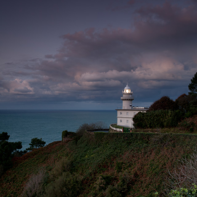 """Panoramic of lighthouse at nightfall"" stock image"