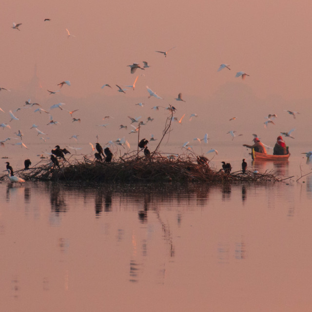 """Fishermen on Lake Taungthaman, Myanmar, at sunrise"" stock image"