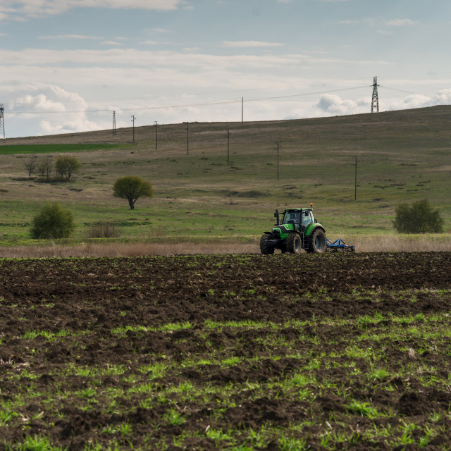 """Tractor plowing fields"" stock image"