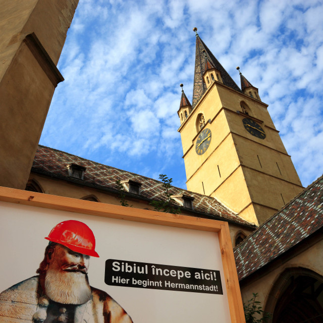 """Bilingual construction sign. Here begins Hermannstadt. At the Evangelical..."" stock image"